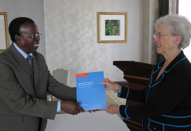 Turner Isoun, Chair of the IAC Panel to Review ASADI, presents the evaluation report to Enriqueta Bond, Chair of the ASADI Board, 10 November 2014, Kampala, Uganda